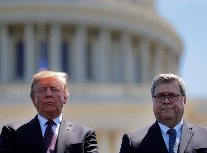 U.S. President Donald Trump and U.S. Attorney General William Barr attend the 38th Annual National Peace Officers Memorial Service on Capitol Hill in Washington, U.S., May 15, 2019. Picture taken May 15, 2019. REUTERS/Carlos Barria/Files