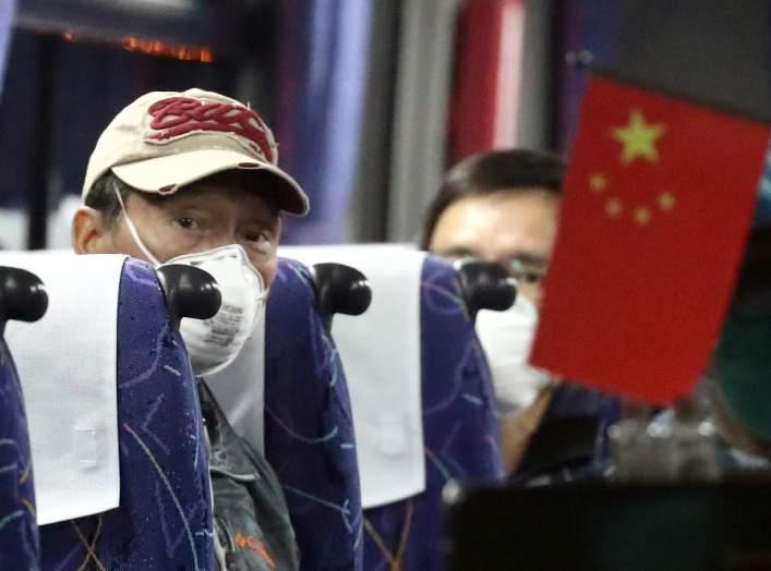 Hong Kong passengers are seen inside a bus as they leave the coronavirus-hit cruise ship Diamond Princess at Daikoku Pier Cruise Terminal in Yokohama, south of Tokyo, Japan February 21, 2020. REUTERS/Athit Perawongmetha