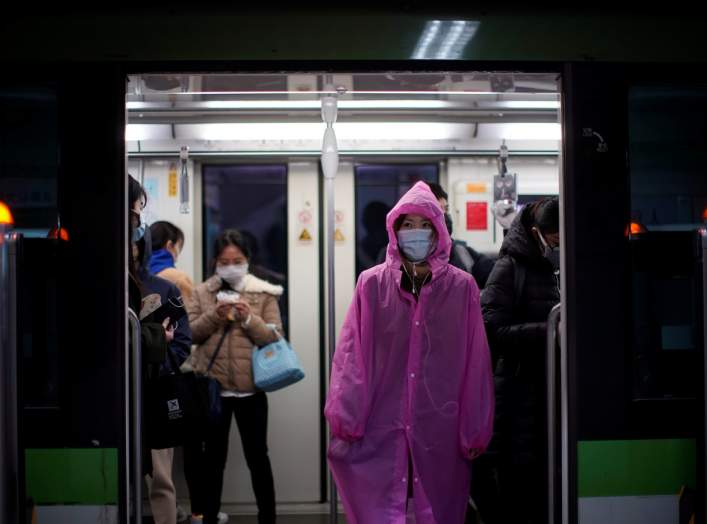 A woman wearing face mask is seen on a subway as the country is hit by an outbreak of the novel coronavirus, in Shanghai, China March 2, 2020. REUTERS/Aly Song