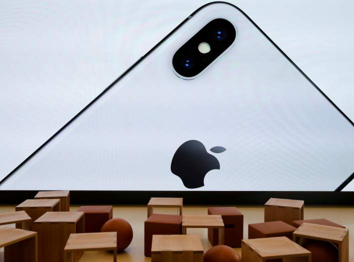 An iPhone X is seen on a large video screen in the new Apple Visitor Center in Cupertino, California, U.S., November 17, 2017. REUTERS/Elijah Nouvelage