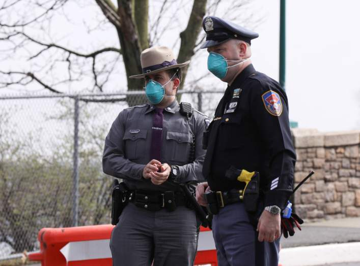 Police guard area where New York State's first drive through coronavirus mobile testing center opened in New Rochelle, New York, U.S., March 13, 2020. REUTERS/Caitlin Ochs