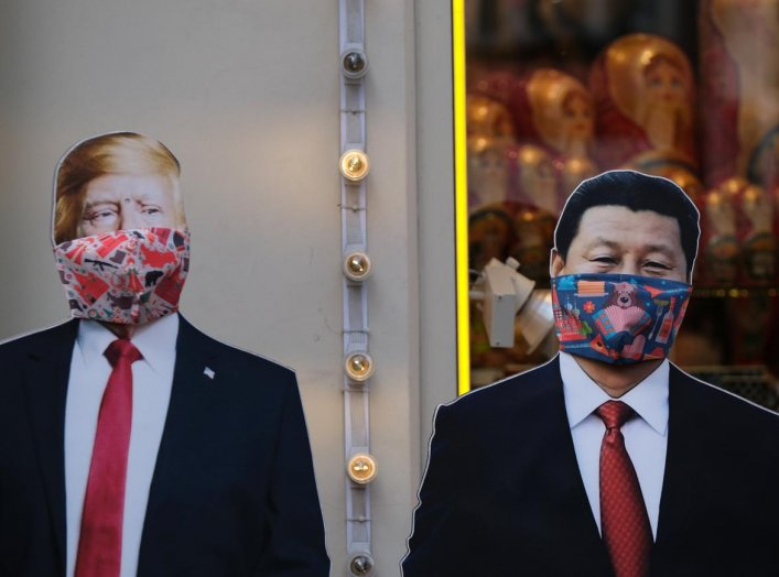 A view shows cardboard cutouts, displaying images of U.S. President Donald Trump and Chinese President Xi Jinping, with protective masks widely used as a preventive measure against coronavirus disease (COVID-19), near a gift shop in Moscow, Russia March 2
