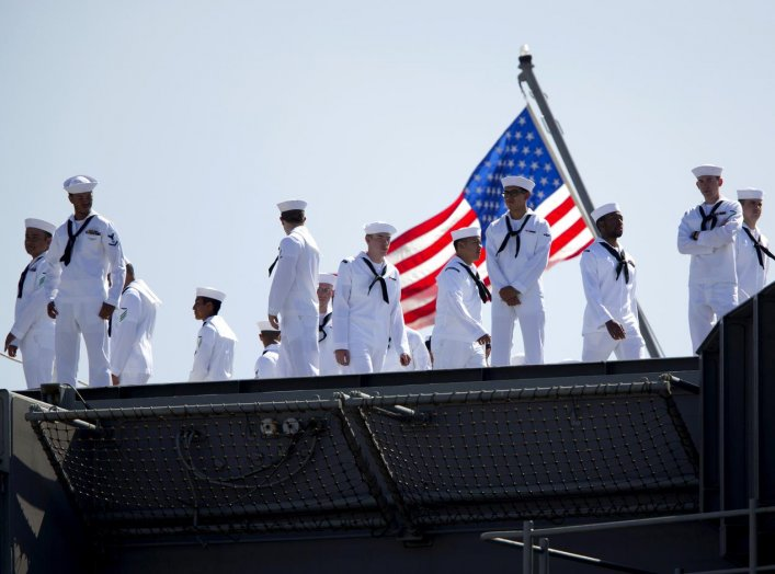 Sailors man the rails as the USS Ronald Reagan, a Nimitz-class nuclear-powered super carrier, departs for Yokosuka, Japan from Naval Station North Island in San Diego, California August 31, 2015. REUTERS/Mike Blake