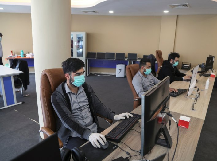 School media department staff are editing online classes, following the outbreak of the coronavirus disease (COVID-19) in the holy city of Karbala, Iraq March 26, 2020. REUTERS/Abdullah Dhiaa Al-Deen