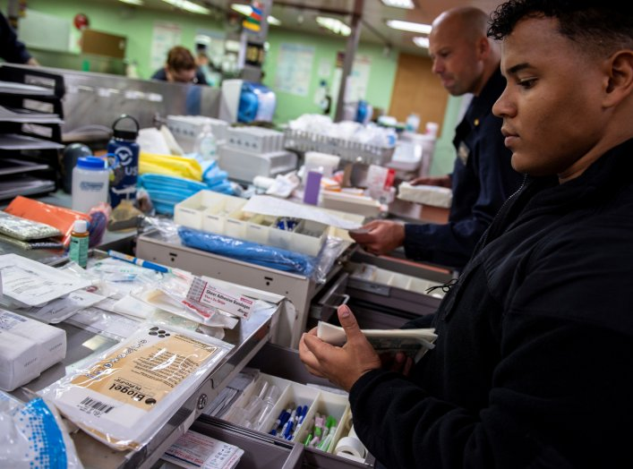 Hospitalman Jeremiah Lewis, from San Antonio, organizes medical supplies aboard the Military Sealift Command hospital ship USNS Mercy off the coast of southern California March 24, 2020. Picture taken March 24, 2020. U.S. Navy/Mass Communication Specialis
