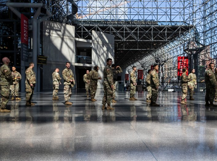 U.S. Army personnel are seen at the Jacob K. Javits Convention Center, which will be partially converted into a hospital for patients affected by the coronavirus disease (COVID-19) in Manhattan in New York City, New York, U.S., March 27, 2020. REUTERS/Jee