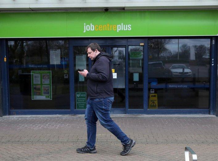 A man walks past a job centre as the spread of the coronavirus disease (COVID-19) continues, Stevenage, Britain, March 31, 2020. REUTERS/Peter Cziborra