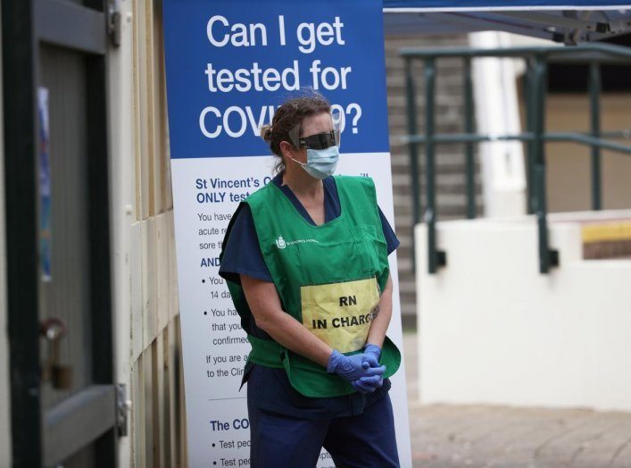 A healthcare professional waits at a pop-up clinic testing for the coronavirus disease (COVID-19) at Bondi Beach, after several outbreaks were recorded in the area, in Sydney, Australia April 1, 2020. REUTERS/Loren Elliott