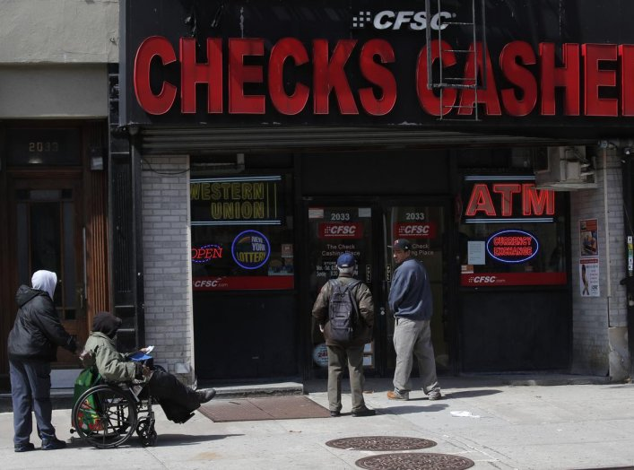 People line-up outside a check cashing and bill pay location as New York residents' rent becomes due on the first of the month in Manhattan during the outbreak of the coronavirus disease (COVID-19) in New York City, New York, U.S., April 1, 2020. REUTERS/