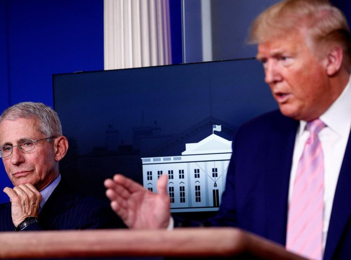 Dr. Anthony Fauci, director of the National Institute of Allergy and Infectious Diseases, listens as U.S. President Donald Trump addresses the daily coronavirus response briefing at the White House in Washington, U.S., April 1, 2020. REUTERS/Tom Brenner