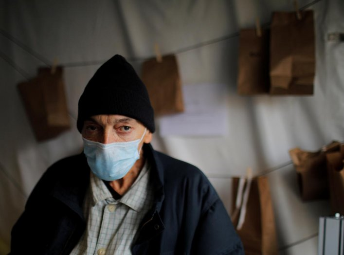 Kevin Keeley, who has been homeless for eight months and may have come in contact with someone with coronavirus disease (COVID-19), poses for a portrait outside a quarantine tent run by Boston Health Care for the Homeless in Boston, Massachusetts, U.S., A