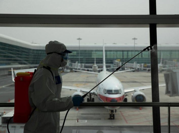 A firefighter in protective suit disinfects Wuhan Tianhe International Airport before the airport resumes its domestic flights on April 8, in Wuhan, Hubei province, the epicentre of China's novel coronavirus disease (COVID-19) outbreak, April 3, 2020. Chi