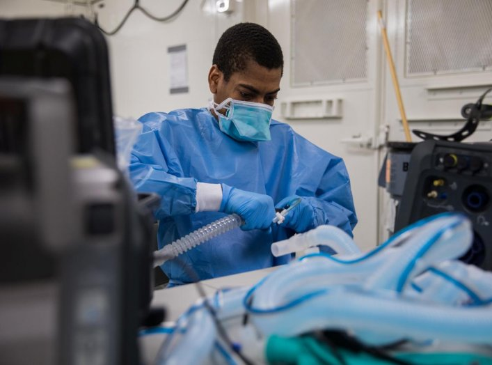 U.S. Army Specialist Fredrick Spencer assembles a T1 Hamilton ventilator in a mobile lab unit in the Javits New York Medical Station intensive care unit bay monitoring coronavirus disease (COVID-19) patients in New York City, U.S. April 4, 2020. U.S. Navy