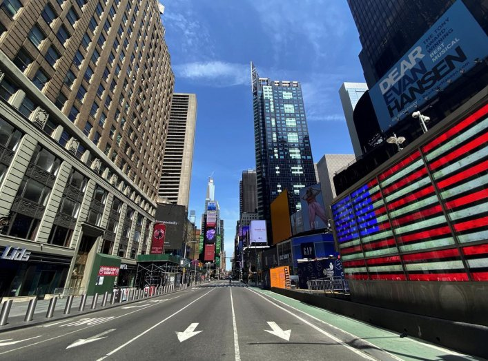 A nearly deserted 7th Avenue in Times Square is seen near midday in Manhattan during the outbreak of the coronavirus disease (COVID-19) in New York City, New York, U.S., April 7, 2020. REUTERS/Mike Segar