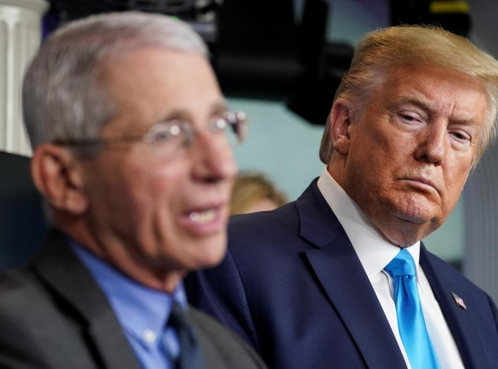 U.S. President Donald Trump listens as Dr. Anthony Fauci, director of the National Institute of Allergy and Infectious Diseases, addresses the daily coronavirus task force briefing at the White House in Washington, U.S., April 7, 2020. REUTERS/Kevin Lamar