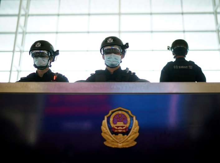 Police officers wearing face masks are seen at the Wuhan Tianhe International Airport after travel restrictions to leave Wuhan, the capital of Hubei province and China's epicentre of the novel coronavirus disease (COVID-19) outbreak, were lifted, April 8,