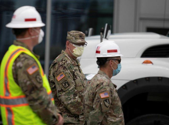 Members of the U.S. Army Corps of Engineers stand outside the Miami Beach Convention Center as they prepare to build a coronavirus field hospital inside the facility, amid the coronavirus (COVID-19) disease outbreak, in Miami Beach, Florida, U.S., April 8