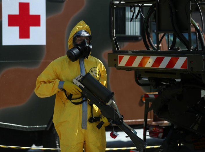 A Brazilian army officer and member of the Biological Radiological and Nuclear Chemical Defense Battalion, demonstrates tactics to combat the new coronavirus pandemic, amid the coronavirus disease (COVID-19) outbreak, at army headquarters in Rio de Janeir