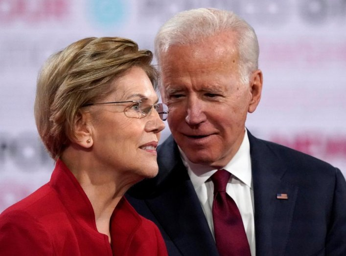 Democratic U.S. presidential candidates Senator Elizabeth Warren and former Vice President Joe Biden talk onstage before the start of the sixth Democratic presidential candidates campaign debate at Loyola Marymount University in Los Angeles, California, U