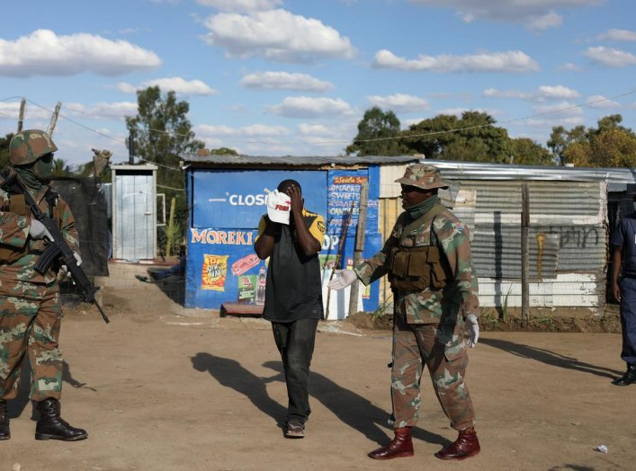 Soldiers on patrol interogates a resident amid the spread of the coronavirus disease (COVID-19) continues in Diepsloot, a shantytown north of Johannesburg, South Africa, April 16, 2020. REUTERS/Siphiwe Sibeko