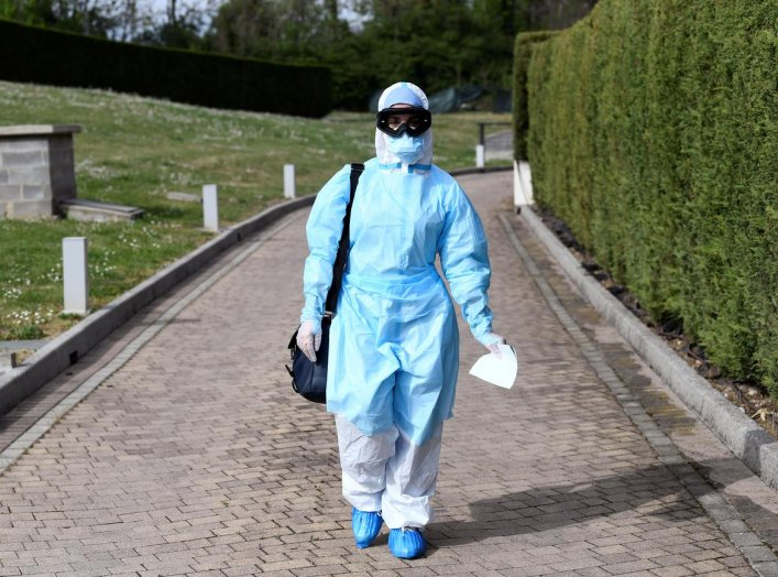 A doctor in protective suit is seen before entering a hotel where people suffering from the coronavirus disease (COVID-19) are quarantined, in Bergamo, the epicentre of Italy's outbreak, April 16, 2020. REUTERS/Flavio Lo Scalzo