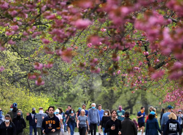 People are seen beneath blossoming trees in Central Park during the outbreak of the coronavirus disease (COVID-19) in Manhattan, New York City, New York, U.S., April 19, 2020. REUTERS/Andrew Kelly