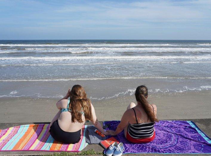 People sunbath on the sidewalk as beaches are closed to limit the spread of the coronavirus disease (COVID-19) in Galveston, Texas, U.S., April 20, 2020. REUTERS/Go Nakamura