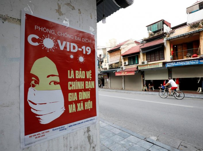A poster warning about the coronavirus disease (COVID-19) is seen on a street in Hanoi, Vietnam April 20, 2020. REUTERS/Kham