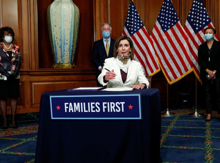 U.S. Speaker of the House Nancy Pelosi (D-CA) signs H.R. 266, the Paycheck Protection Program Healthcare Enhancement Act, an additional economic stimulus package that passed earlier in the week by the U.S. Senate, during a signing ceremony on Capitol Hill