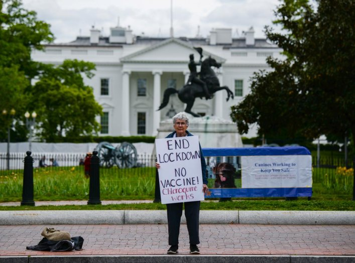 Kathy Boylan protests business closings, amid the spread of the coronavirus disease (COVID-19), in front of the White House in Washington, U.S., April 25, 2020. REUTERS/Erin Scott