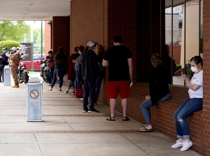 People who lost their jobs wait in line to file for unemployment following an outbreak of the coronavirus disease (COVID-19), at an Arkansas Workforce Center in Fort Smith, Arkansas, U.S. April 6, 2020. REUTERS/Nick Oxford