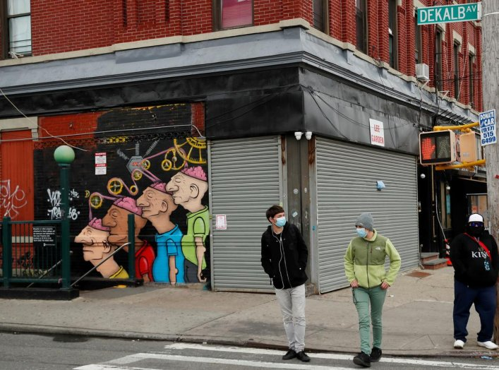 Pedestrians wearing masks walk in front of shuttered buildings as the spread of the coronavirus disease (COVID-19) outbreak continues in the Brooklyn borough of New York City, U.S., April 27, 2020. REUTERS/Lucas Jackson
