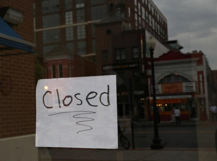 A closed sign is visible on the window of a business during the outbreak of the coronavirus (COVID-19) disease in Washington, U.S., April 29, 2020. REUTERS/Leah Millis
