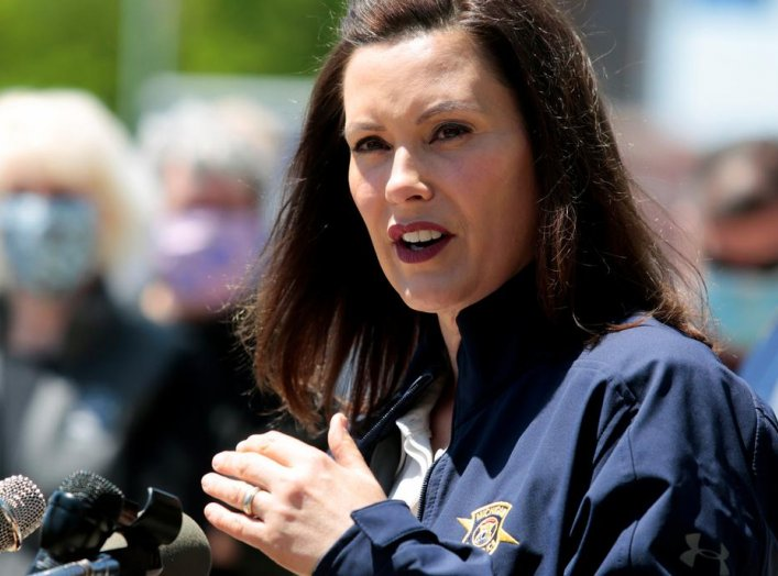 Michigan Governor Gretchen Whitmer addresses the media about the flooding along the Tittabawassee River, after several dams breached, in downtown Midland, Michigan, U.S., May 20, 2020. REUTERS/Rebecca Cook