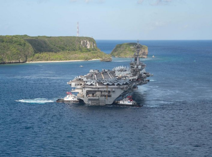 The U.S. Navy aircraft carrier USS Theodore Roosevelt departs following an extended visit in the midst of a coronavirus disease (COVID-19) outbreak, from Apra Harbor, Guam May 21, 2020. Picture taken May 21, 2020. U.S. Navy/Mass Communication Specialist S