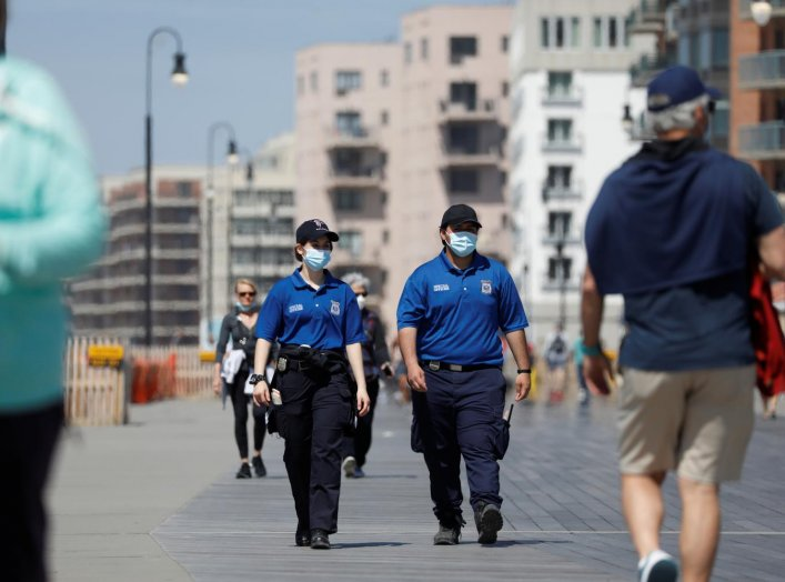 Special Police Officers patrol the boardwalk at Long Beach on the first day that New York beaches were opened ahead of the Memorial Day weekend following the outbreak of the coronavirus disease (COVID-19) on Long Island, New York, U.S., May 22, 2020. REUT