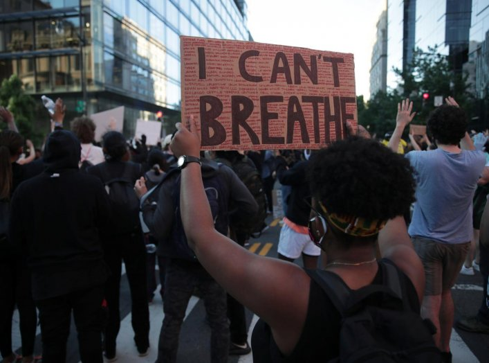 "A protester holds up a ""I can't breathe"" sign during a rally against the death in Minneapolis police custody of George Floyd, in Washington, D.C., U.S. May 31, 2020. REUTERS/Jonathan Ernst"