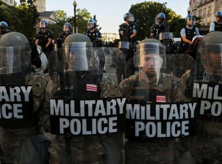 DC National Guard Military Police officers and law enforcement officers stand guard during a protests against the death in Minneapolis custody of George Floyd, near the White House in Washington, D.C., U.S., June 1, 2020. REUTERS/Jonathan Ernst