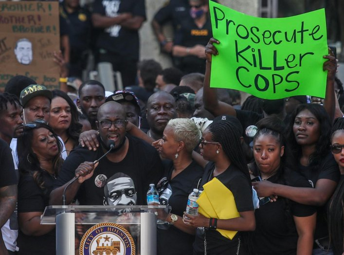 Philonise Floyd, brother of George Floyd, who died in Minneapolis police custody, is surrounded by family members as he speaks at a protest rally against his brother's death, in Houston, Texas, U.S., June 2, 2020. REUTERS/Adrees Latif