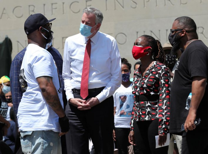 Terrence Floyd (L) George Floyd's brother, speaks with New York City Mayor Bill de Blasio as they attend a public memorial after the death in Minneapolis police custody of George Floyd in the Brooklyn borough of New York City, New York, U.S., June 4, 2020