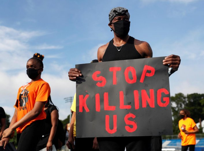 People attend a protest against racial inequality in the aftermath of the death in Minneapolis police custody of George Floyd, in Malverne, New York, U.S., June 10, 2020. REUTERS/Shannon Stapleton