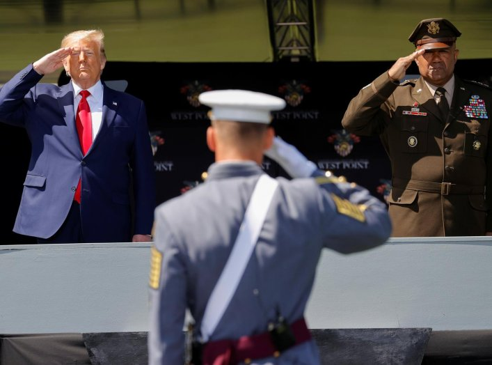 U.S. President Donald Trump salutes alongside U.S. Army Lieutenant General Darryl Williams, the Superintendent of the U.S. Military Academy at West Point, as he prepares to deliver the commencement address at the 2020 United States Military Academy Gradua