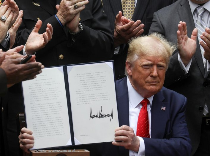 U.S. President Donald Trump displays an executive order on police reform during a signing ceremony in the Rose Garden at the White House in Washington, U.S., June 16, 2020. REUTERS/Leah Millis
