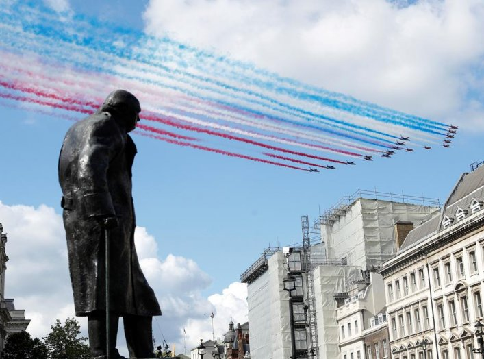 The Red Arrows and La Patrouille de France perform a flypast over a statue of Winston Churchill, during a meeting of British Prime Minister Boris Johnson and French President Emmanuel Macron in London, Britain, June 18, 2020. REUTERS/Peter Nicholls