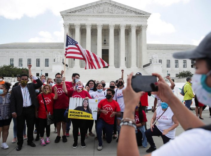 DACA recipients and their supporters celebrate outside the U.S. Supreme Court after the court ruled in a 5-4 vote that U.S. President Donald Trump's 2017 move to rescind the Deferred Action for Childhood Arrivals (DACA) program, created in 2012 by his Dem