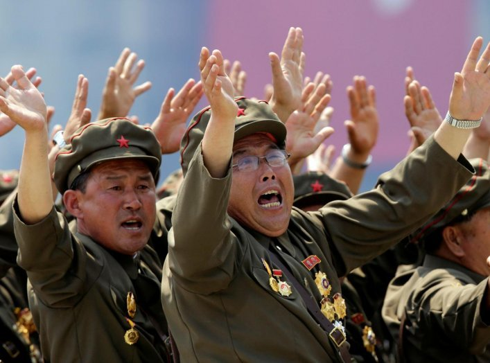 Korean War veterans react as they shout slogans to North Korean leader Kim Jong-un during a parade to mark the 60th anniversary of the signing of a truce in the 1950-1953 Korean War, at Kim Il-sung Square in Pyongyang, North Korea, July 27, 2013. REUTERS/