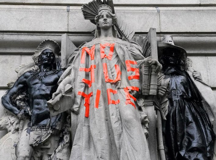 "A defaced statue is pictured across from a protest to defund the police in a place they are calling the ""City Hall Autonomous Zone"" in support of ""Black Lives Matter"" in the Manhattan borough of New York City, New York, U.S., June 30, 2020. REUTERS/Carlo"