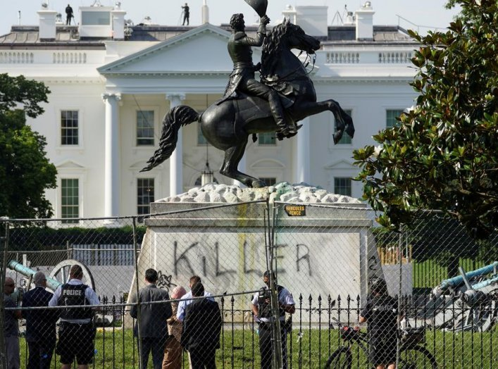 "The word ""Killer"" is seen on the statue of U.S. President Andrew Jackson across from the White House a day after racial inequality protesters attempted to tear down the statue in Washington, D.C., U.S., June 23, 2020. REUTERS/Kevin Lamarque"