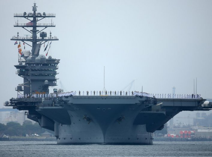 Sailors man the rails as aircraft carrier USS Nimitz with Carrier Strike Group 11, and some 7,500 sailors and airmen depart for a 6 month deployment in the Western Pacific from San Diego, California, U.S., June 5, 2017. REUTERS/Mike Blake