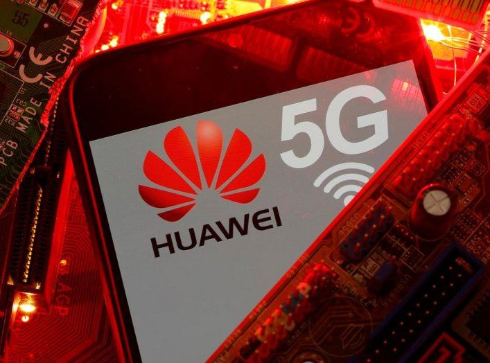 A smartphone with the Huawei and 5G network logo is seen on a PC motherboard in this illustration picture taken January 29, 2020. REUTERS/Dado Ruvic